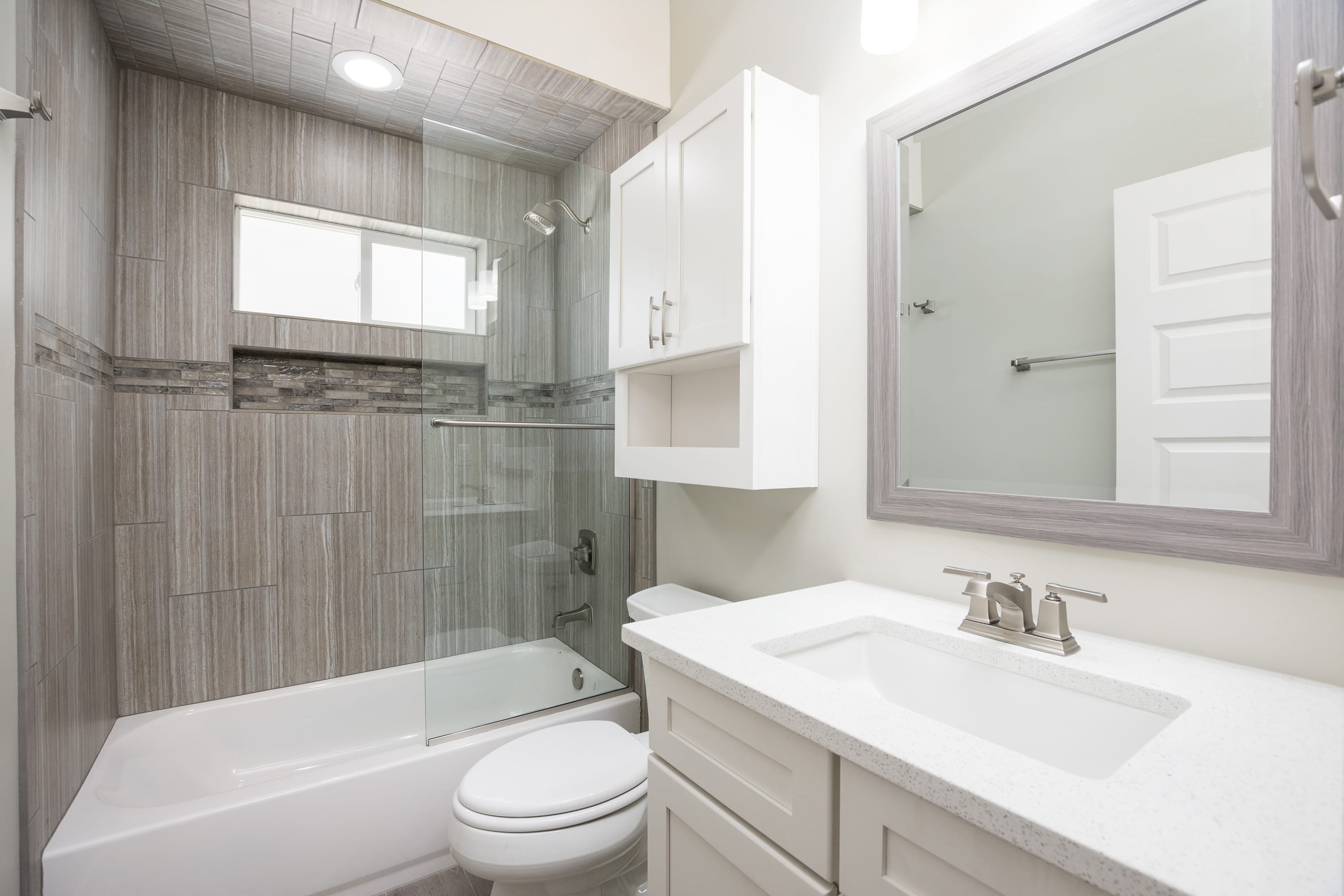 Interior shot of guest bathroom in 2884 Maddox contemporary home