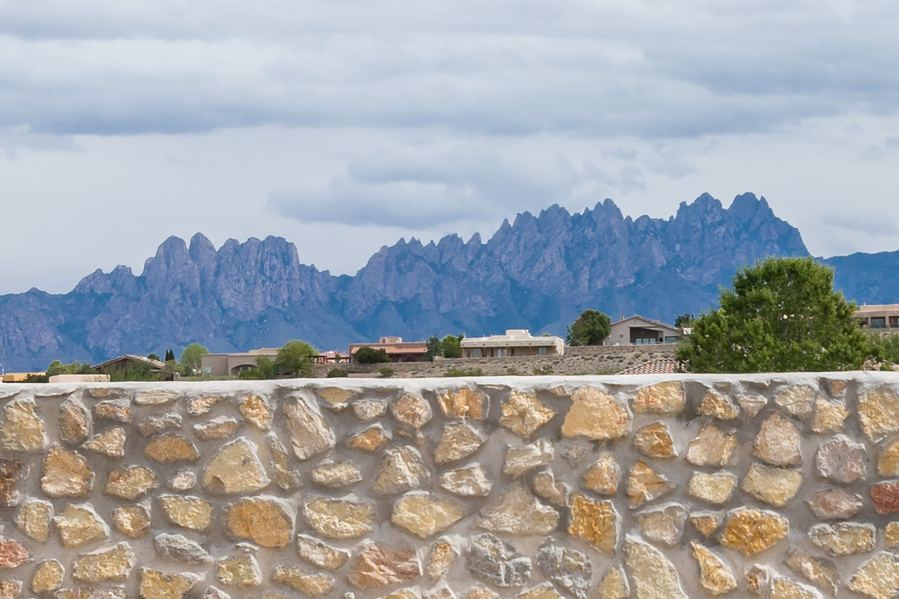 Exterior shot of mountain landscape behind 2884 Maddox contemporary home