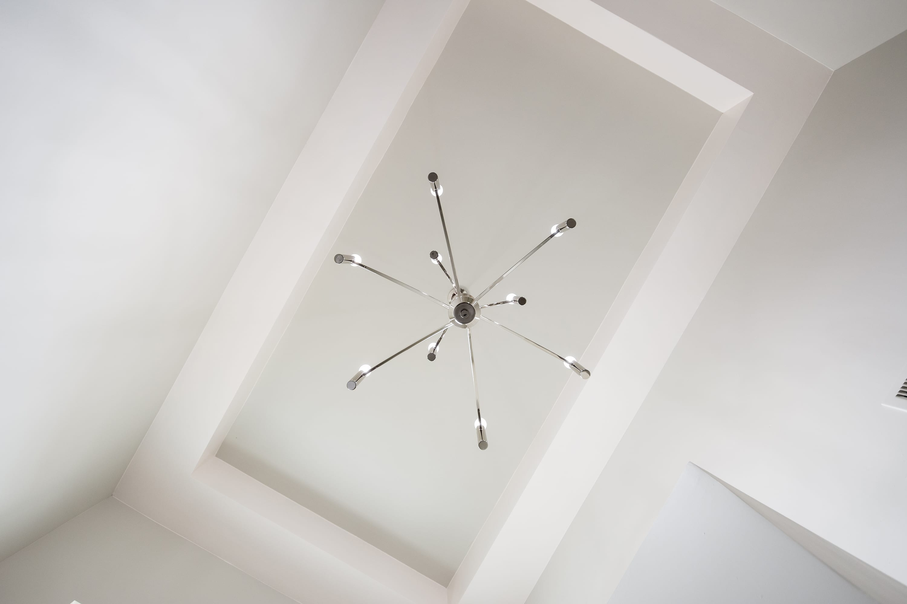 Interior ceiling shot of chandelier in 2884 Maddox contemporary home