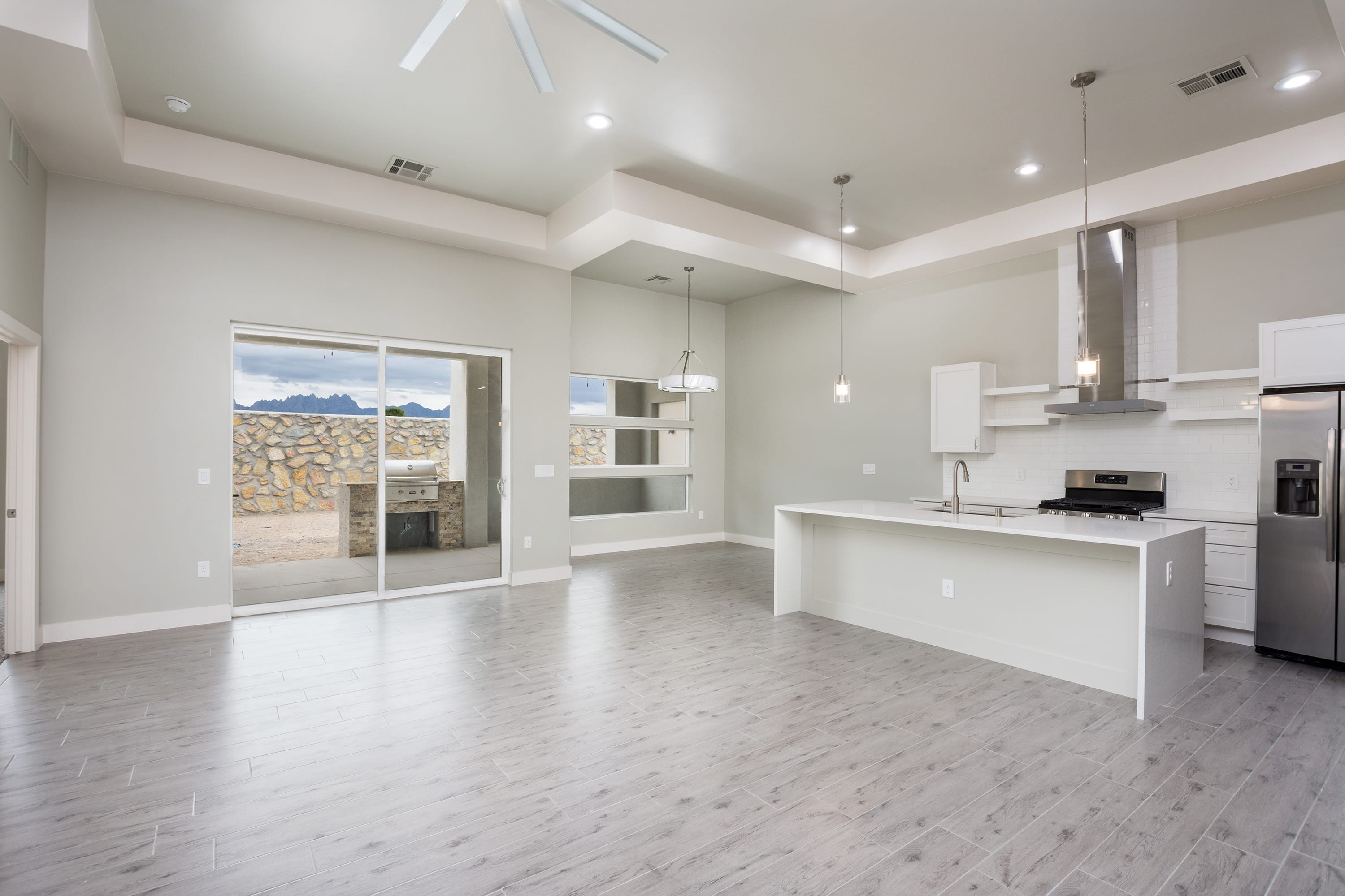 Interior ceiling shot of kitchen and dining area in 2884 Maddox contemporary home