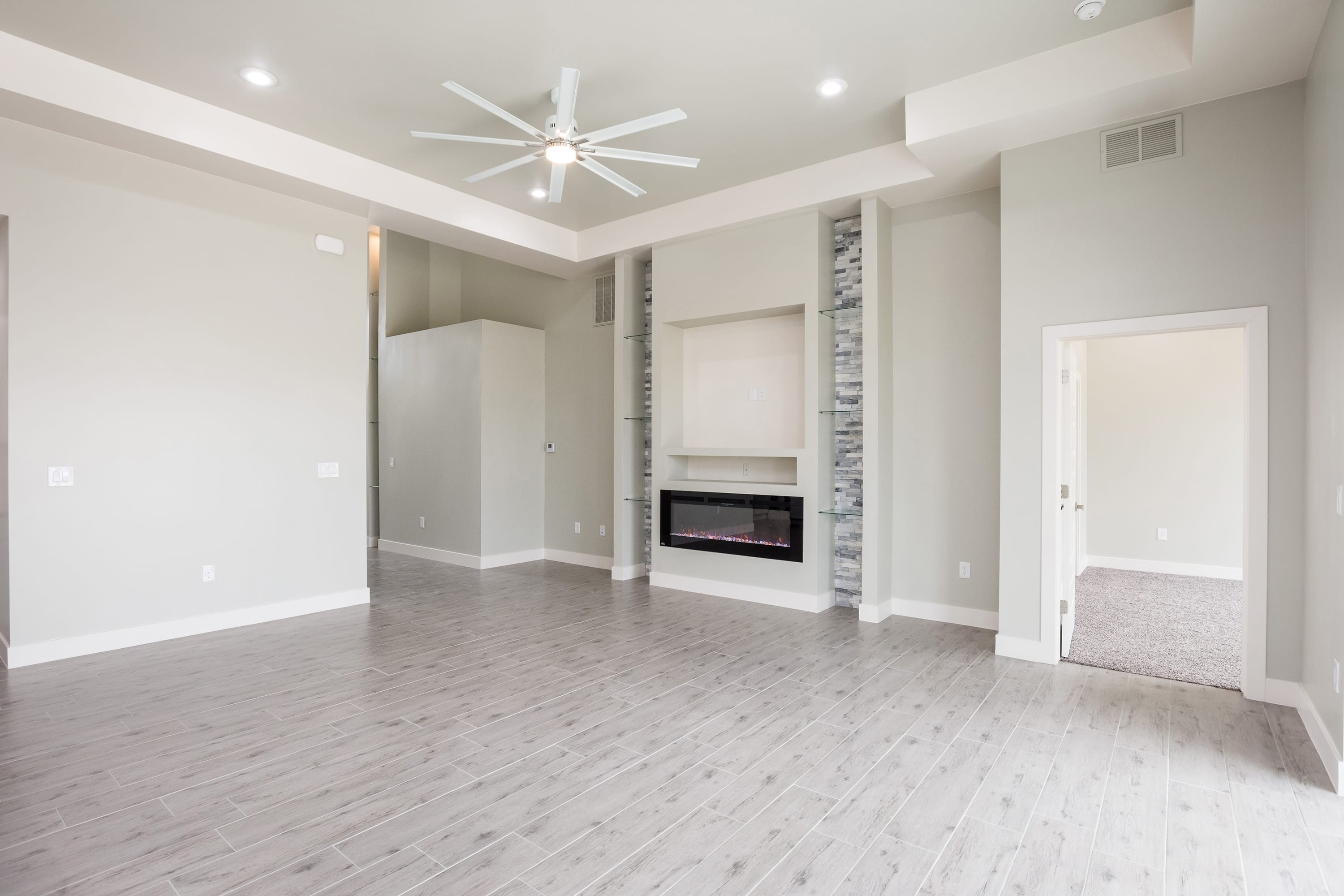 Interior ceiling shot of living area and fireplace in 2884 Maddox contemporary home