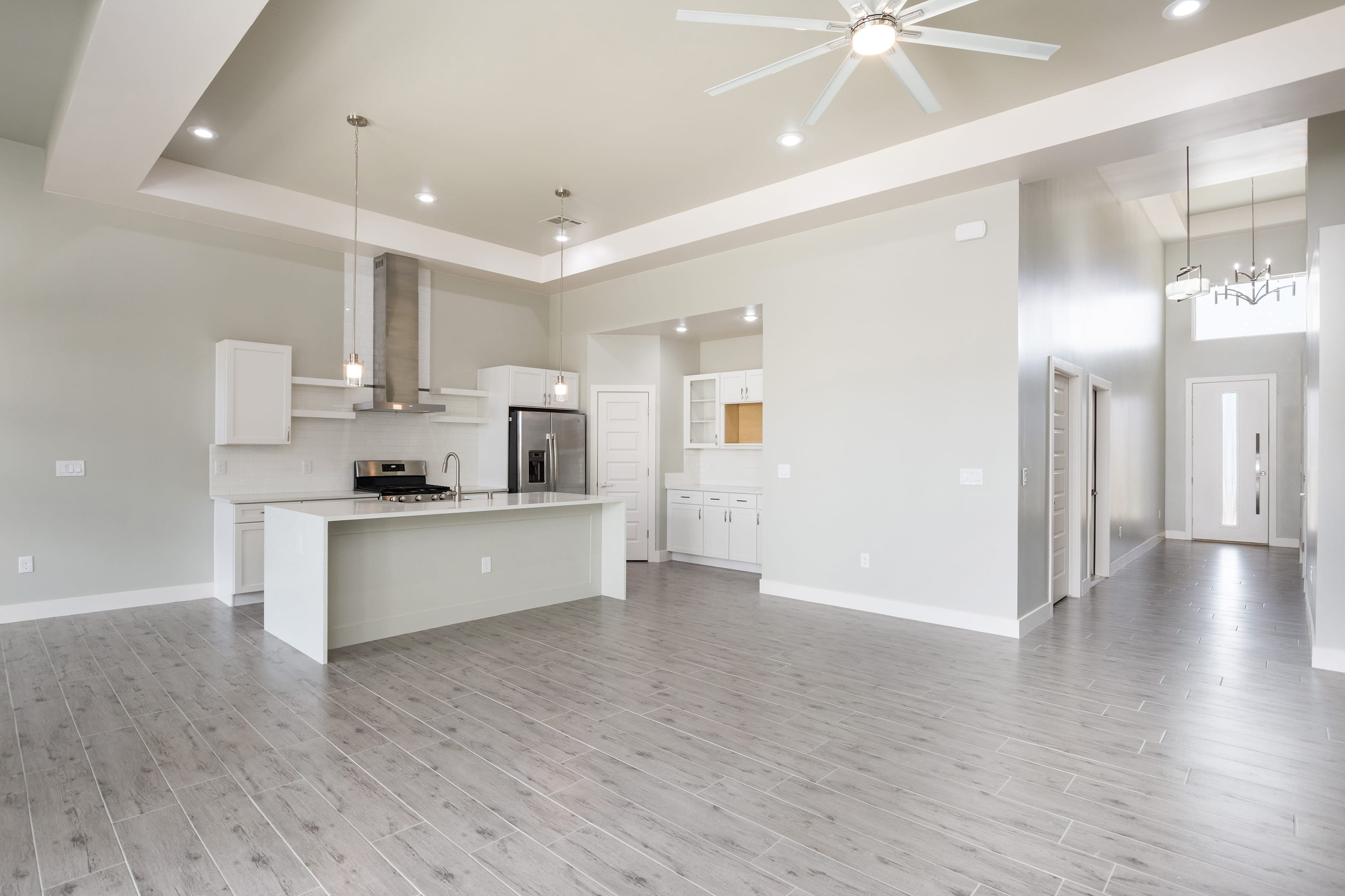 Interior ceiling shot of entryway and kitchen in 2884 Maddox contemporary home