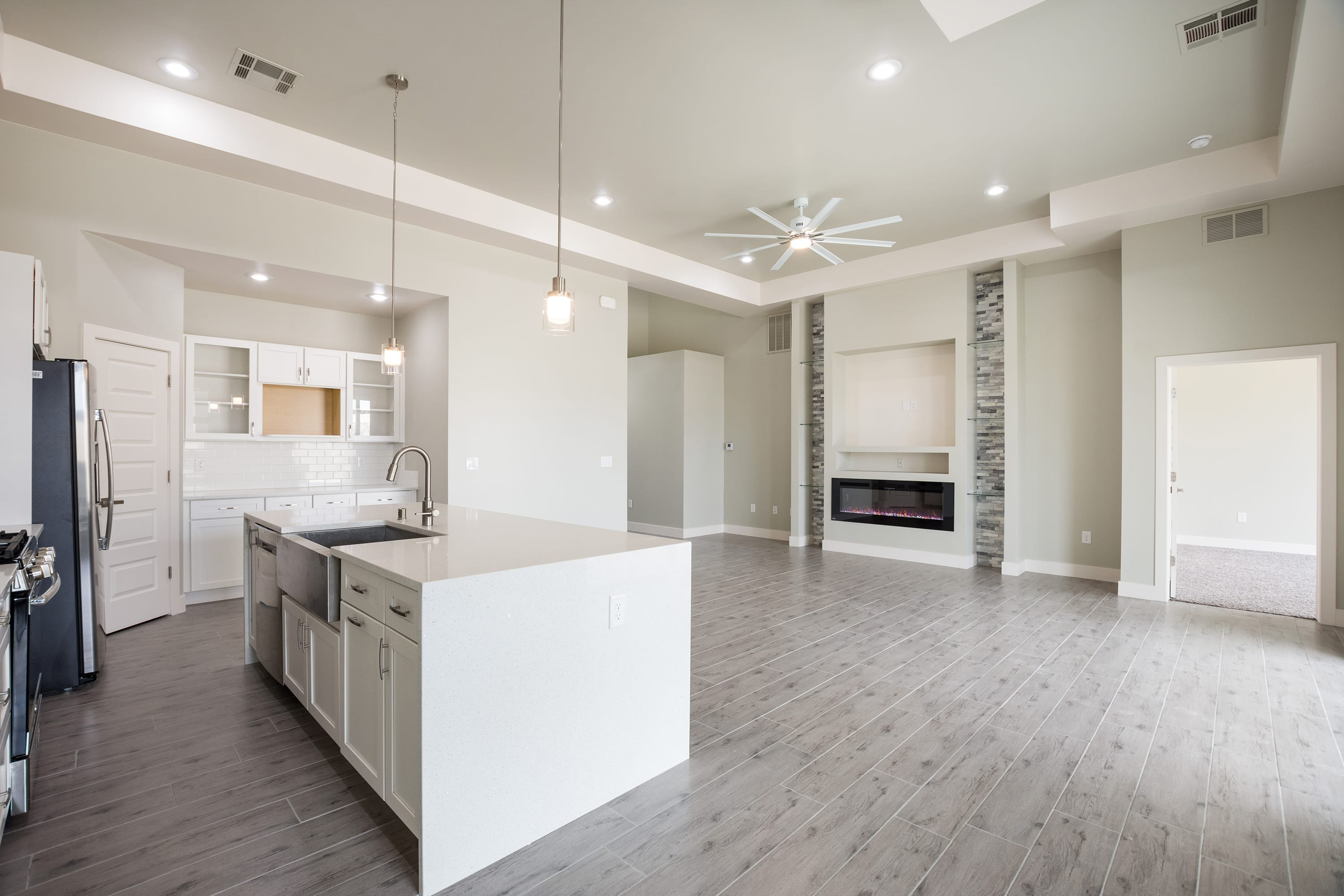 Interior Shot of kitchen and living area in 2884 Maddox contemporary home