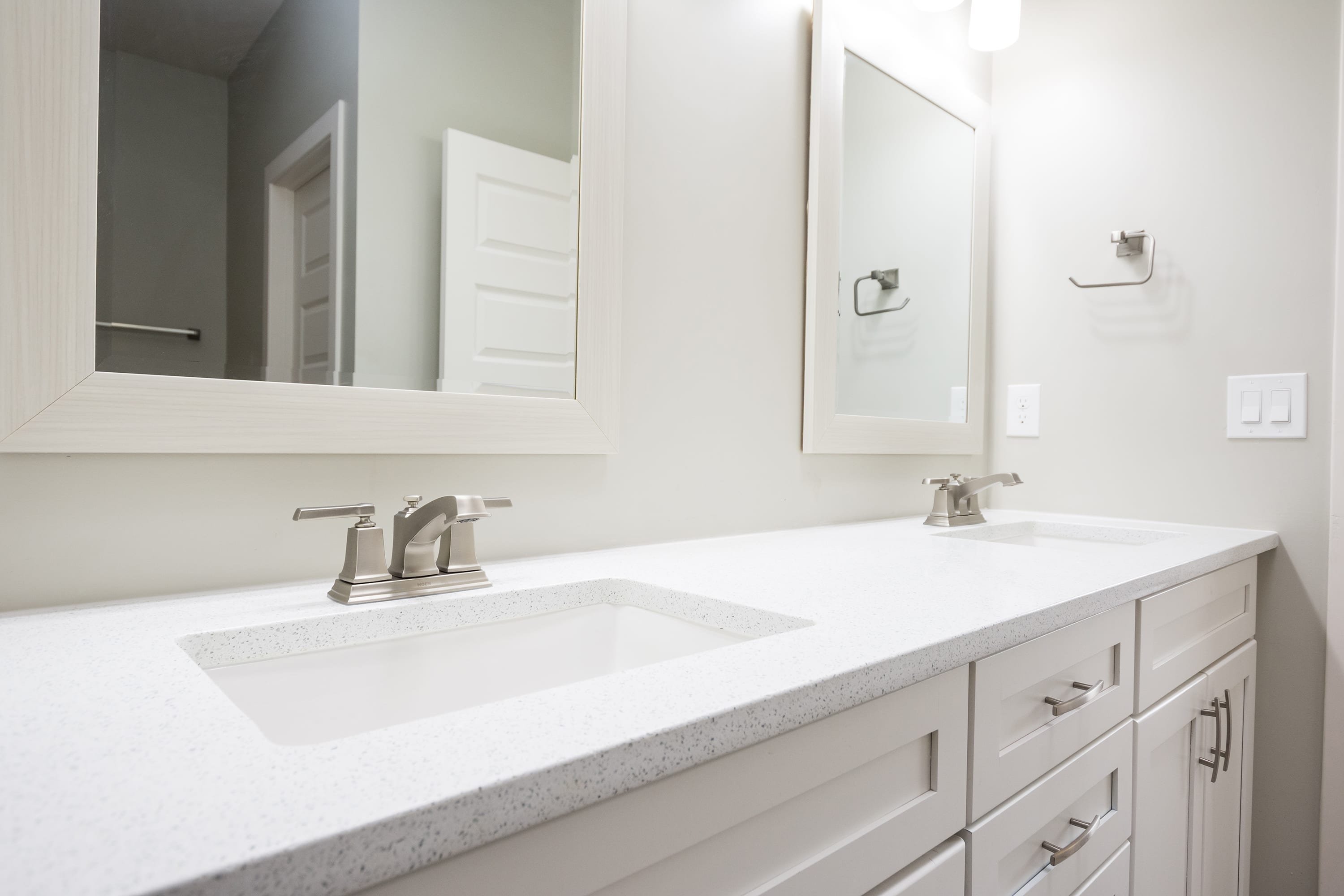Interior shot of master bathroom sinks in 2884 Maddox contemporary home