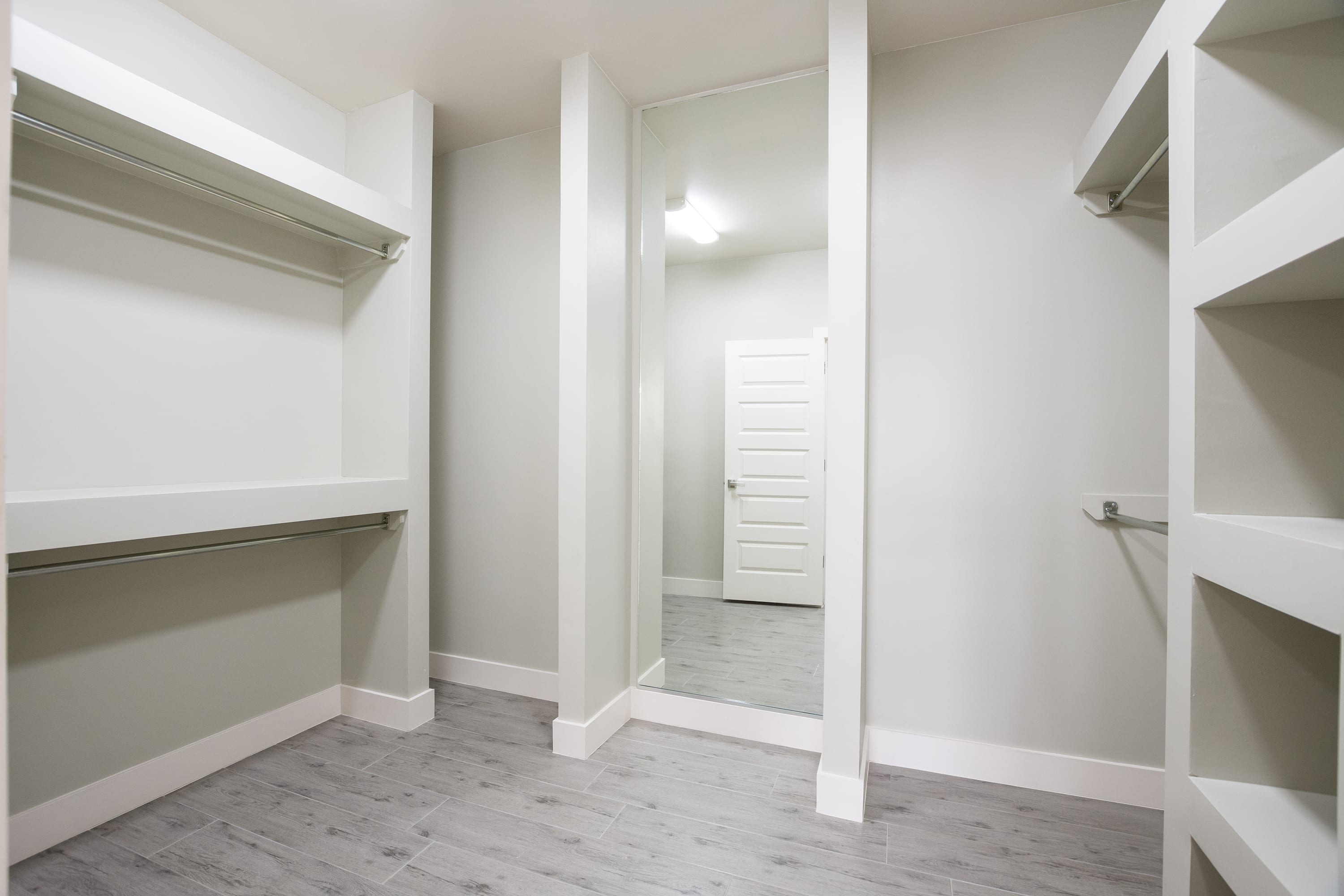 Interior shot of master bedroom walk-in closet in 2884 Maddox contemporary home