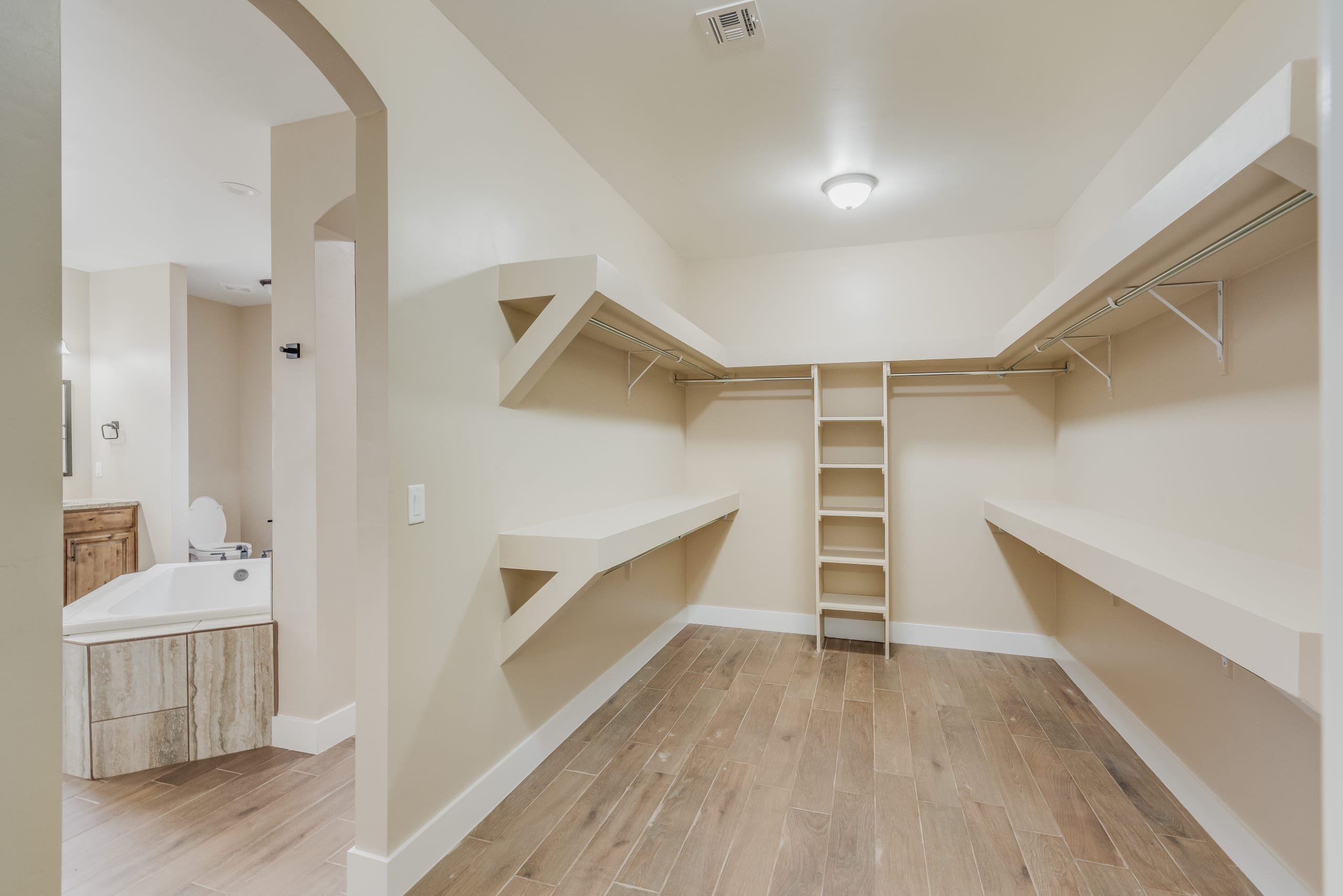 Interior shot of master bedroom walk-in closet in 3420 Calle Bedado