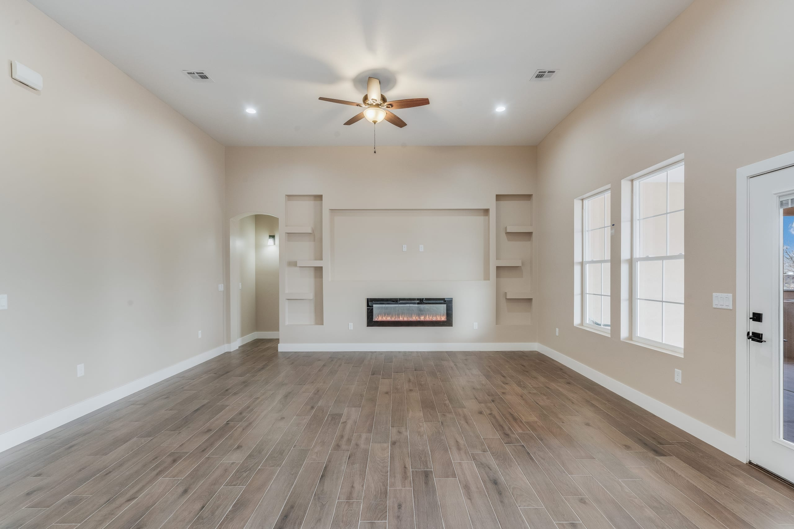 Interior shot of living area and fireplace of 3420 Calle Bedado