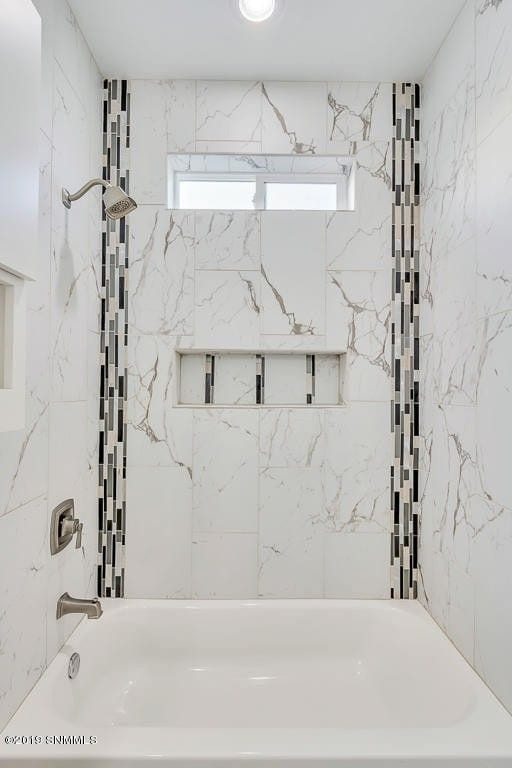 Interior shot of guest bathroom shower in 2190 Pacifico Court