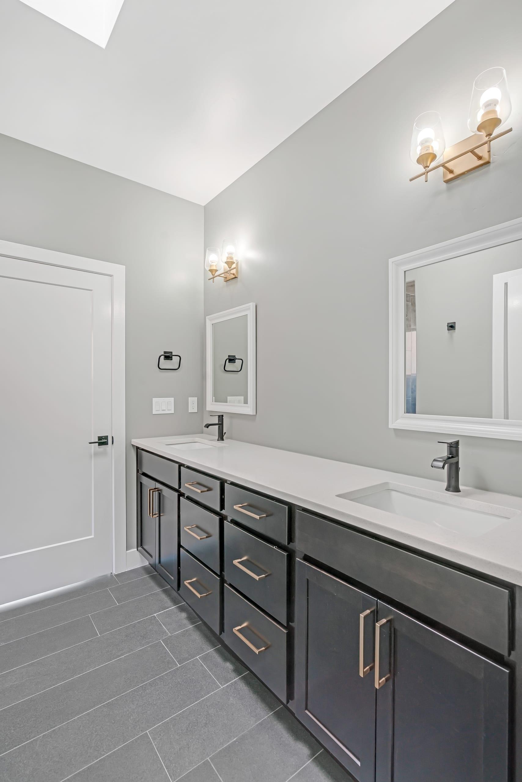 Bathroom - two sinks - vanity mirrors